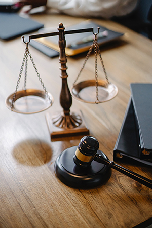 Judge desk with gavel and scales