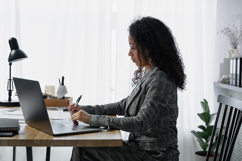 Woman accountant working on her laptop