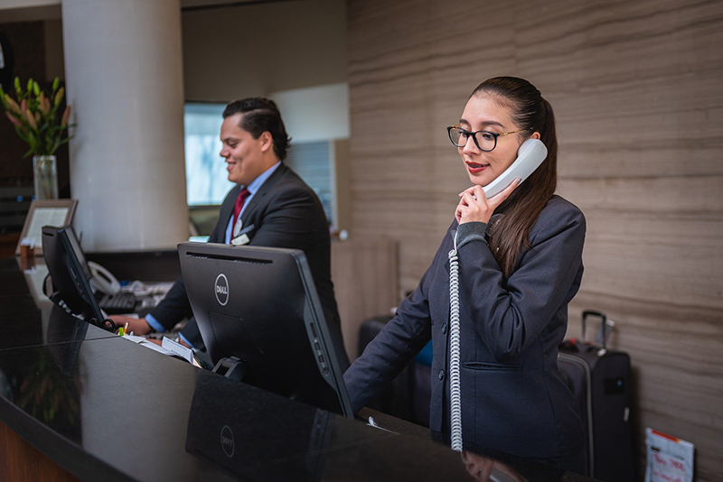 Man and woman receptionist in a hotel