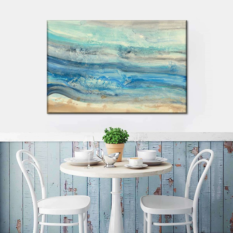 White table and chairs near portrait on the wall