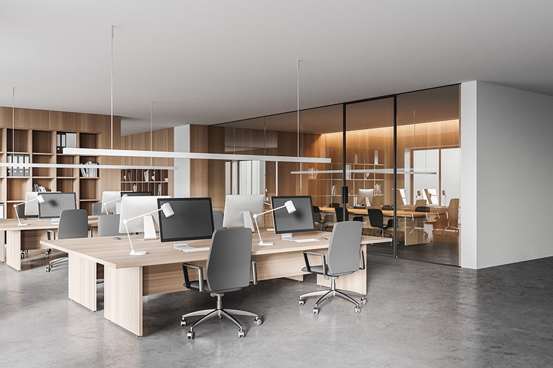 Corner of modern open space office with white and wooden walls, concrete floor and rows of computer tables. Meeting room in the background. 3d rendering