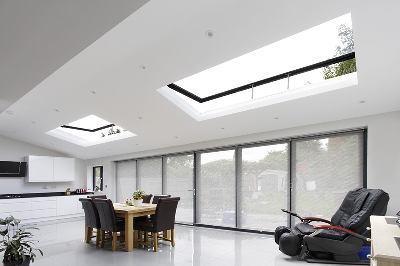 White painted dining room using skylights