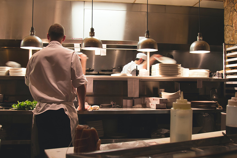 Man wearing white long sleeves working in the kitchen