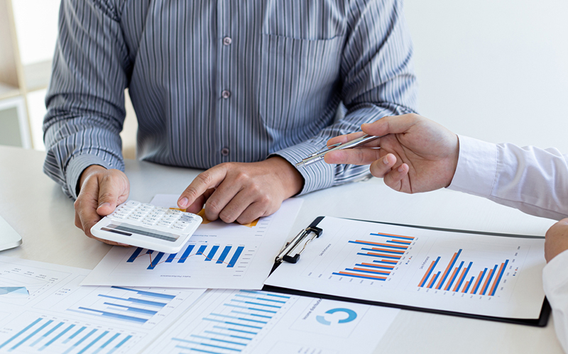 Business team meeting analyze financial graphs market growth reports And corporate income tax, Analysis of financial accounting.