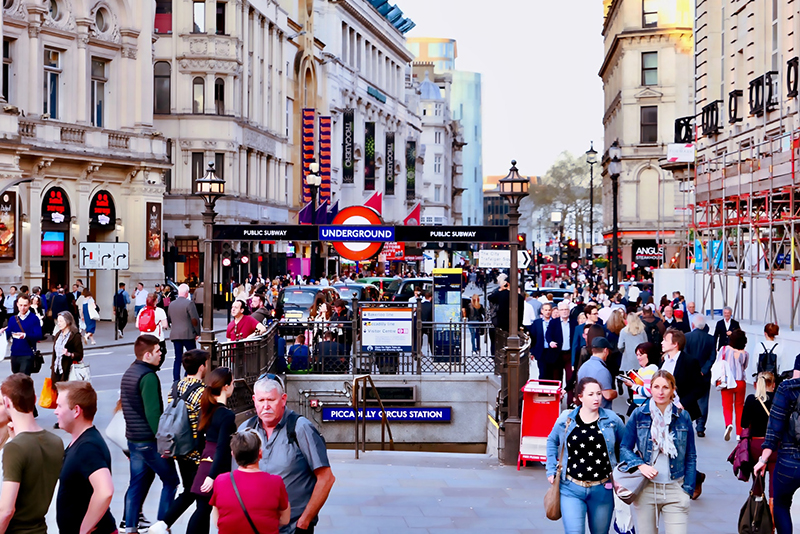 People walking near Picadilly Circus station in London