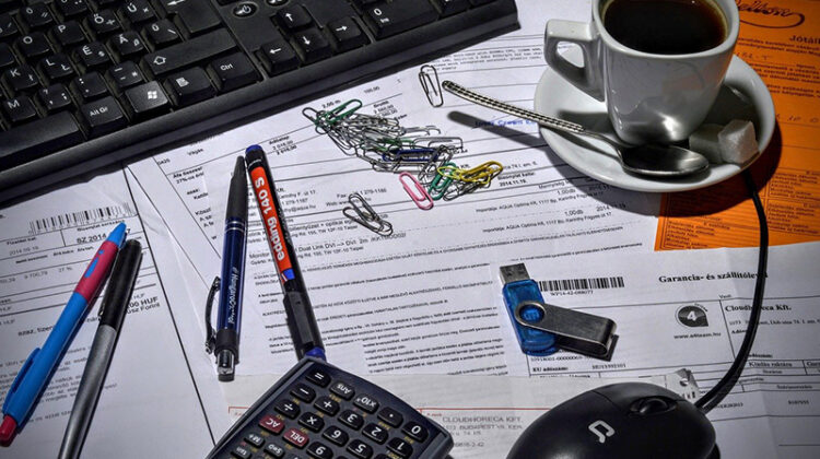 bookkeeper accountant - coffee cup on top of paperwork