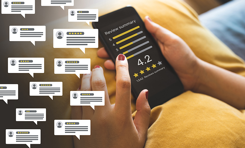 Consumer reviews concepts with bubble people review comments and smartphone.
