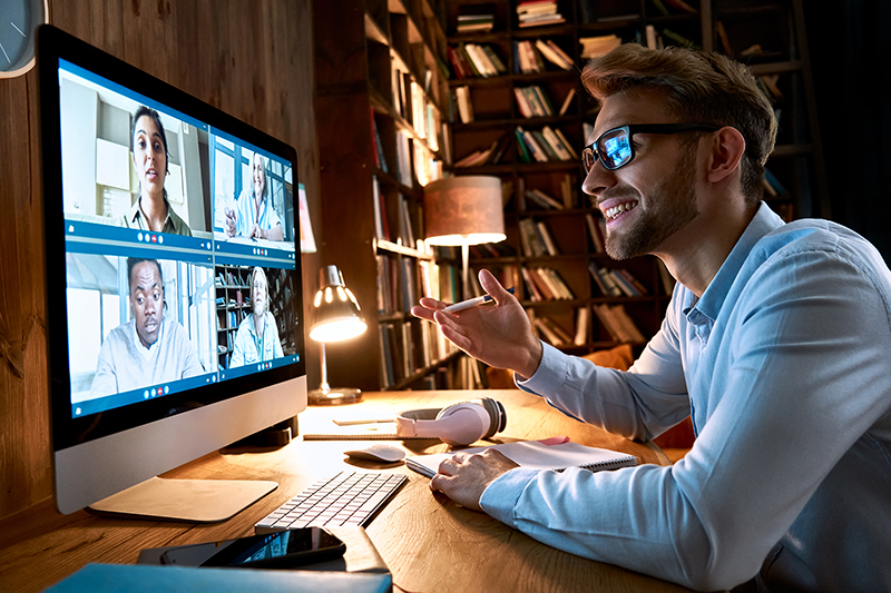 Business man having virtual team meeting on video conference