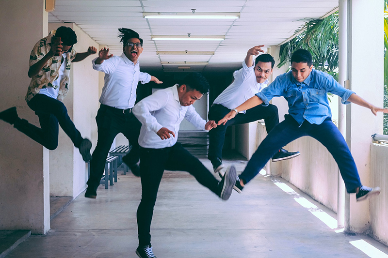 group of employees jumping and captured by shot of them in mid air