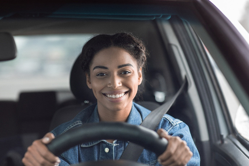 Young female driving car - driving lesson
