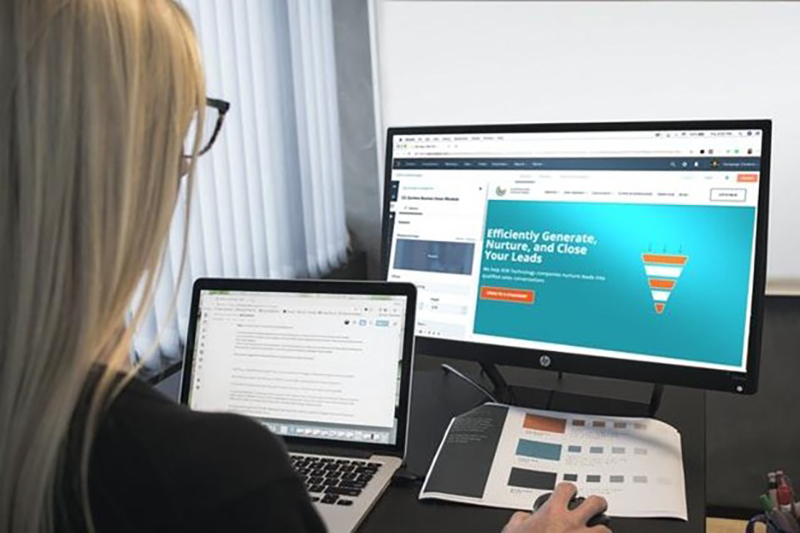 Law firm assistant at work on computer