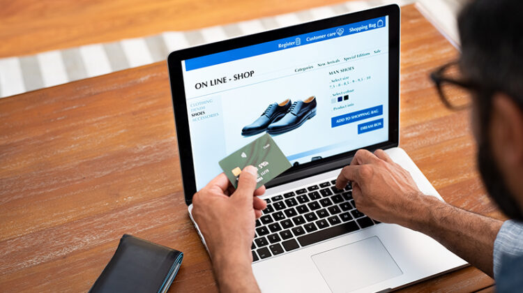 Man buying shoes in online store