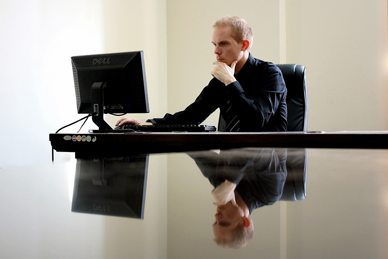 Businessman sitting on his black leather chair