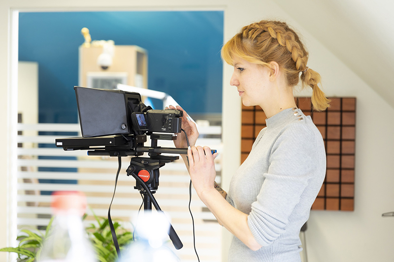 Woman setting up the teleprompter device