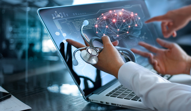 Diagnose checking brain testing result with modern virtual screen interface on laptop with stethoscope in hand