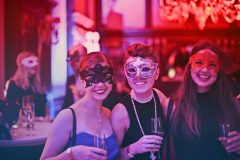 Women wearing masks in the party