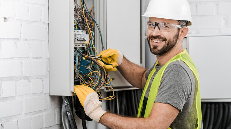 Electrician working in wiring harness