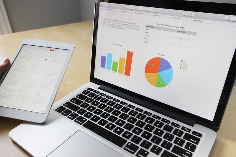 Open laptop with charts and graphs on the screen