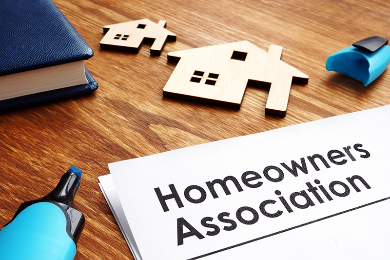 Documents about Homeowners Association HOA on a desk