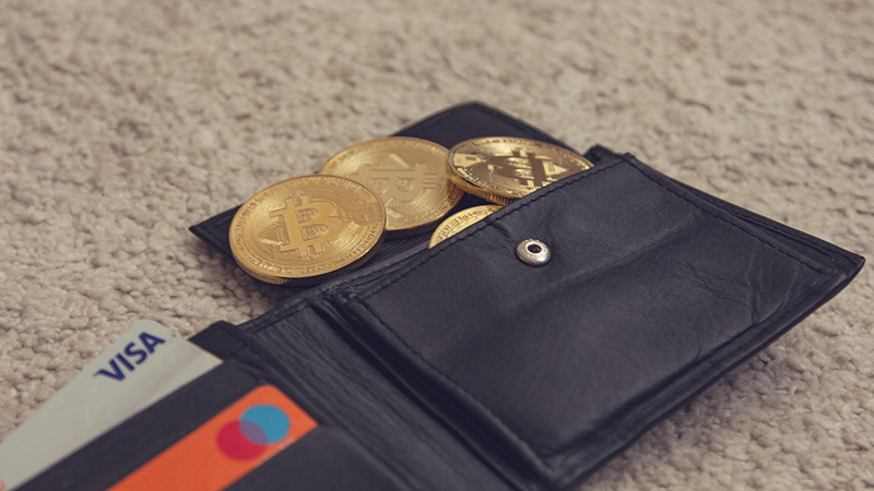 Black leather bifold wllet with gold round coins