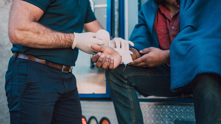 Paramedic administering first aid