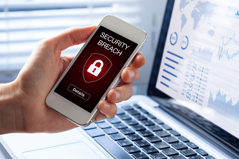 Security breach warning on smartphone screen
