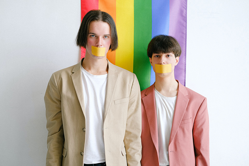 Men with adhesive tape over their mouth