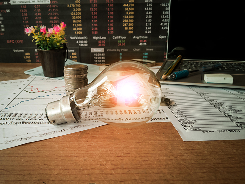 Light bulbs are placed in business documents and financial accounting concepts.