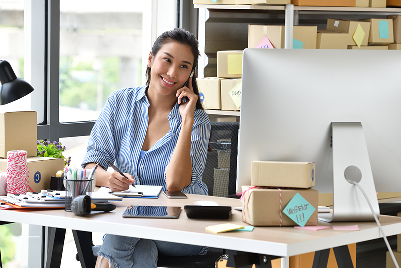 Business owner working with computer at home