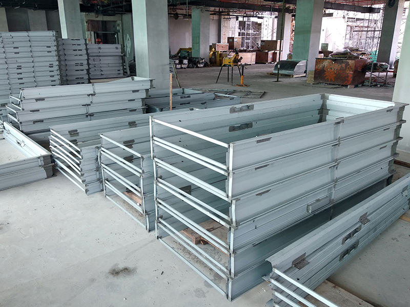 Mild Steel Door Frame stacked horizontally at the construction site.