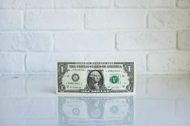 dollar bill on the white table