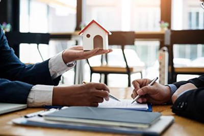 Real estate agent talking to a client