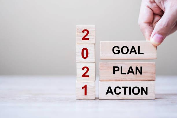 words goal, action, plan, and 2021 written on the wooden blocks