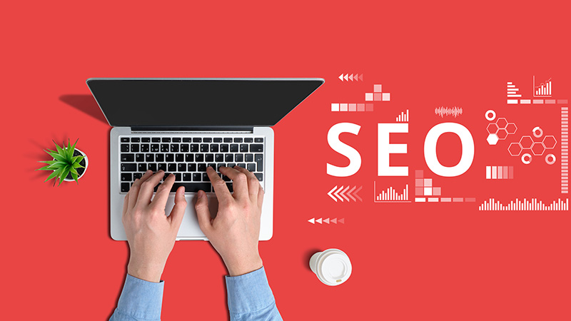Person working in laptop with seo concept