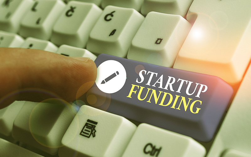Conceptual hand writing showing Startup Funding.