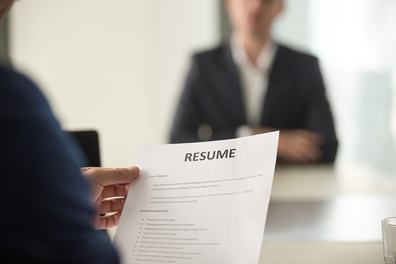 Woman Applicant and interviewer reading the resume