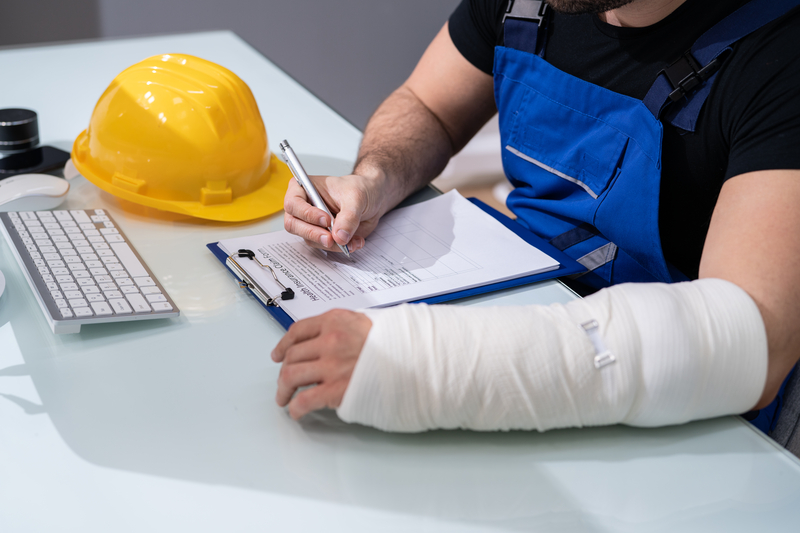 a worker signing a work compensation form