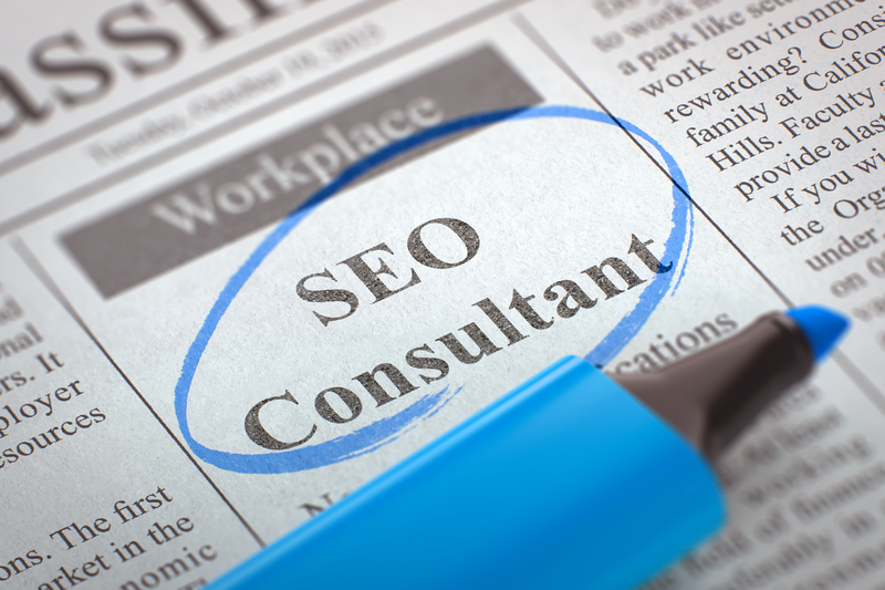 Newspaper with Small Ads of Job Search SEO Consultant