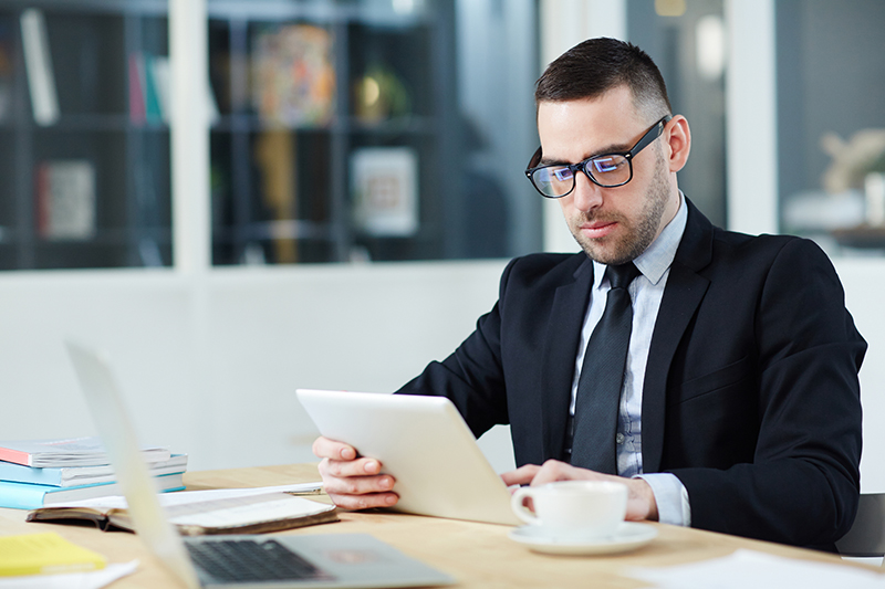 Business broker wearing black suit and eye glasses