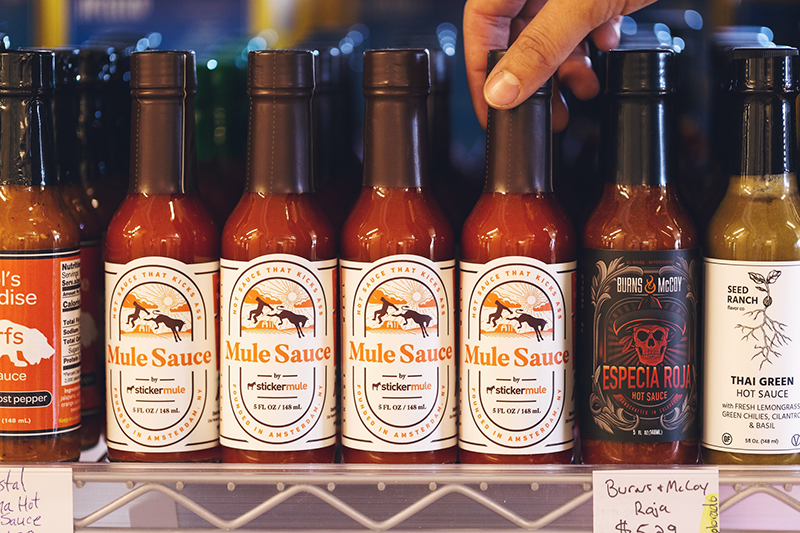 Hot sauce bottles with labels
