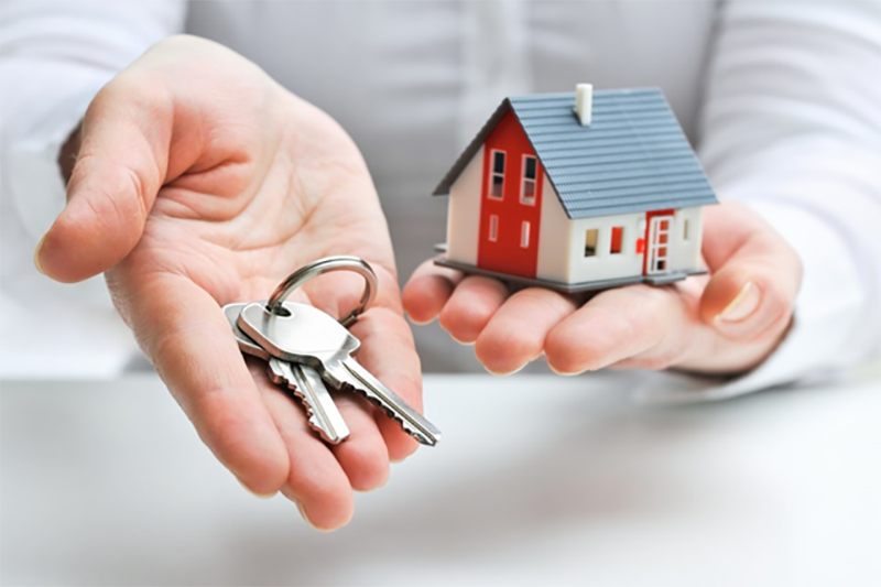 Person handing the house key