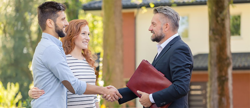 Couple client handshaking with real estate agent