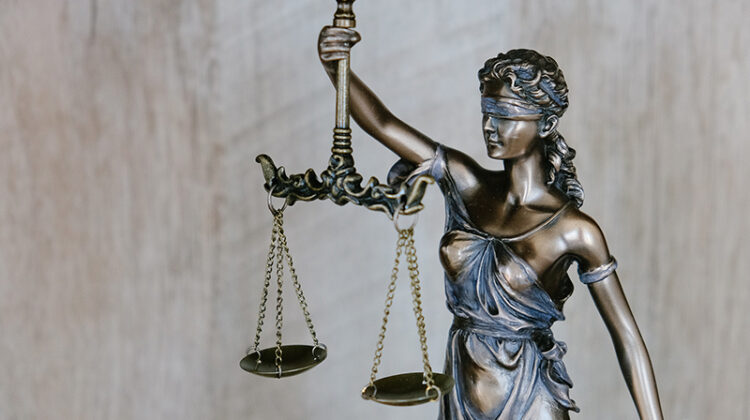 Lady justice wearing a blindfold and holding a sword and scales