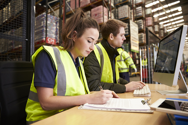People working in warehouse of parcel