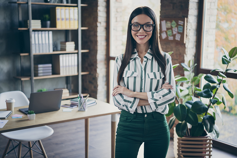 Smiling woman standing on her office