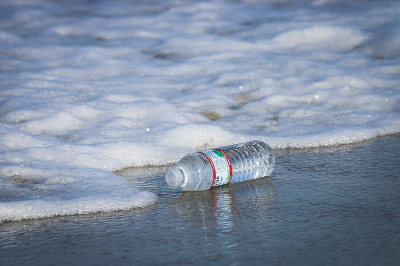 Water plastic bottle on the sea shore