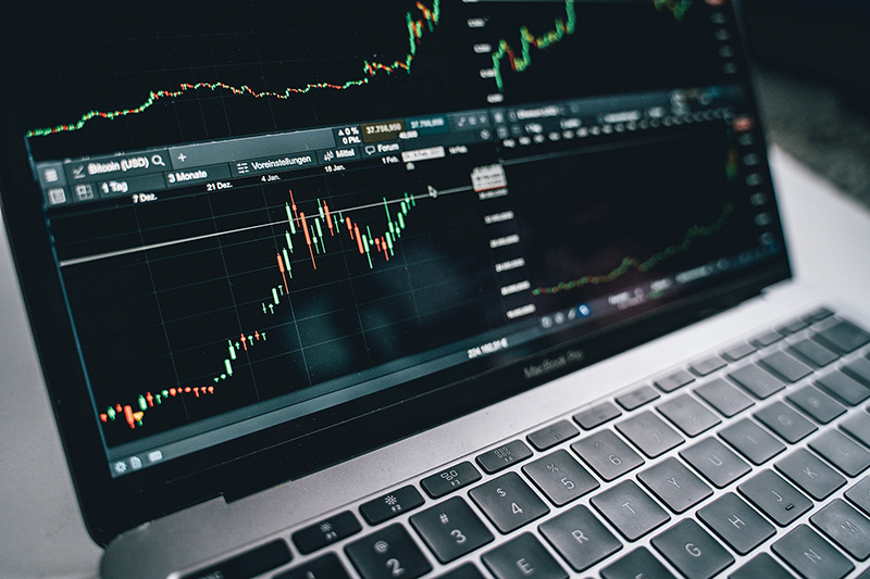 wicks and candles - trading indicators on laptop screen