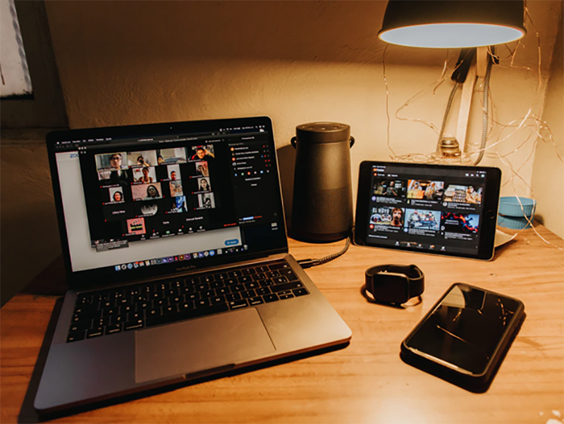 Laptop and iPad on streaming video