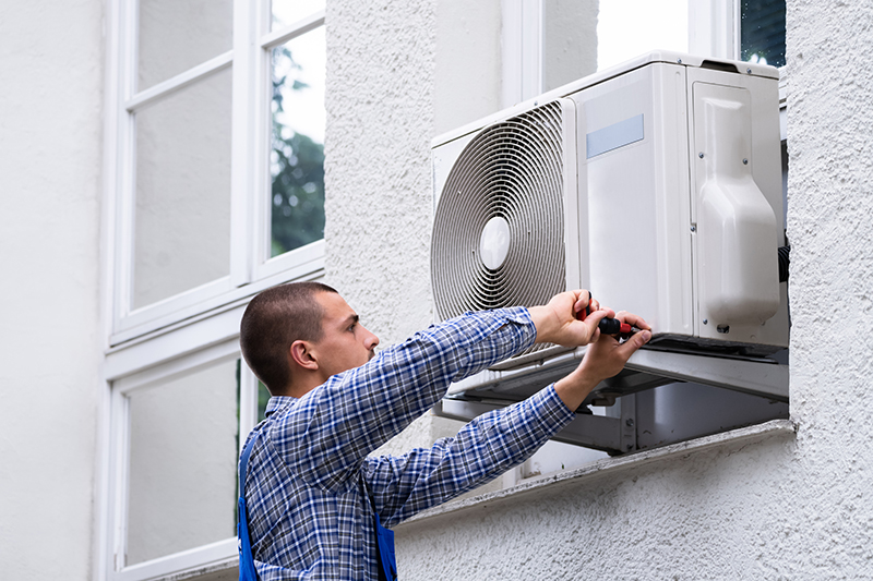 Man working in air conditioning