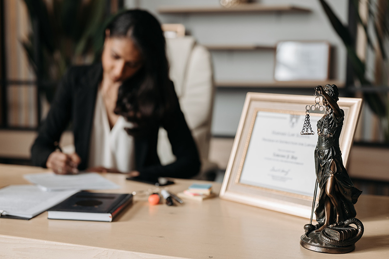 Woman lawyer working on her desk